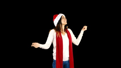 Woman in santa hat and warm clothing looking upwards