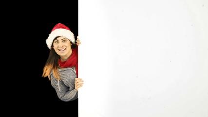 Beauty brunette in santa hat showing white poster