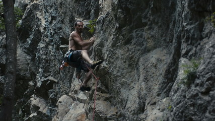 Rock climber on steep limestone Cliff, Turzii Gorge