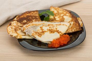 Pancakes with red caviar