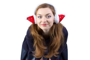 Portrait of happy young woman in winter headphones