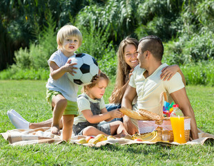 Family of four having picnic