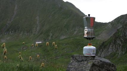 coffee maker boiling in alpine setting