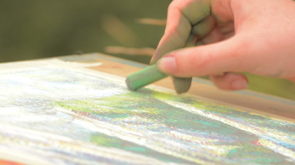 pastel sketching on summer meadow close up