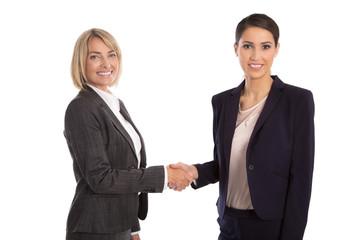 Begrüßung per Handschlag: Kleidungsstil Geschäftsfrau