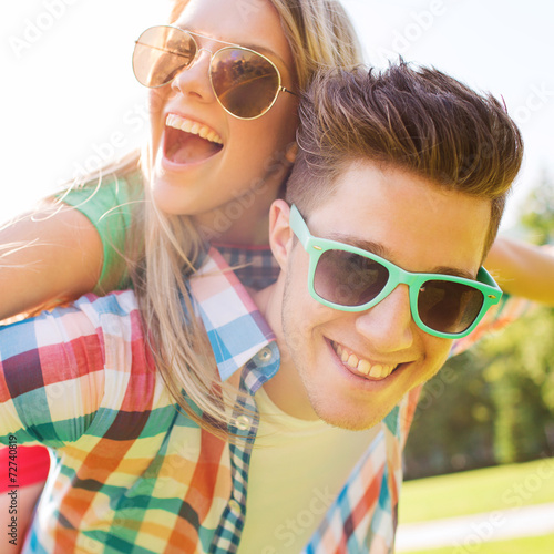 canvas print picture smiling couple having fun in park