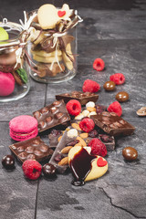 Chocolate. Broken chocolate bar, fruit, macarons  and spices