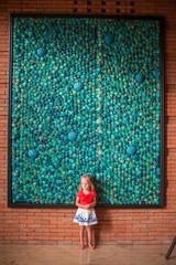 Adorable little girl in big luxury hotel indoor