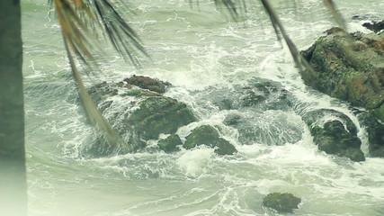 wave stones ocean splashes