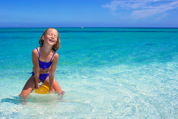 Little cute girl have fun at tropical beach during vacation