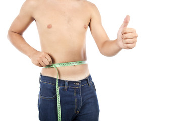 Young man on isolated background with a tape measure