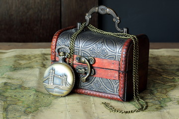 Antique pocket watch on a vintage background