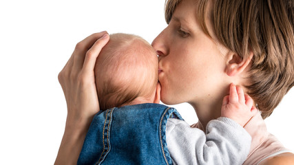 Loving mother kissing her newborn baby