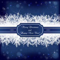 Card for the winter holidays with snowy fir branches on dark blu