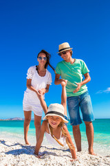 Young happy family have fun during tropical vacation