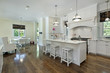 Large kitchen with white cabinetry