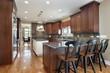 Kitchen with dark tile backsplash