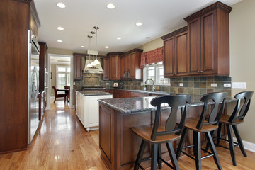 Kitchen with dark tile backsplash