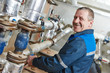 heating engineer repairman in boiler room - 72745633
