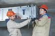 heating engineer repairman in boiler room - 72745657