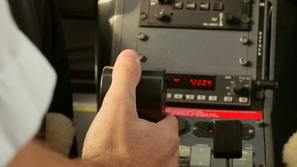 Pilot pushes throttle power control in cockpit with Tilt