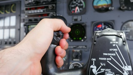 Pilot hand on Airplane Yoke Steering POV Pan