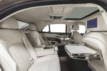 Interior of exclusive car. White leather seats