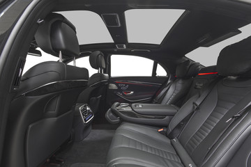 Interior of car. Black leather seats with red ambient light