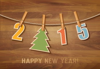 2015 with a christmas tree on wooden background. Vector.