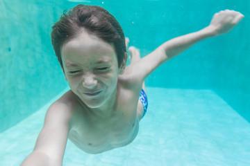 child boy swimming underwater