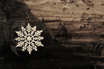 Snowflakes on grunge wooden background. Winter holidays concept