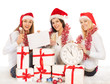 girls on the New Year's Eve sit with clock, gifts