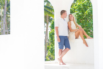 young loving couple on tropical island, outdoor wedding ceremony