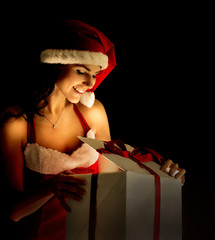 woman opening the magical Christmas present box