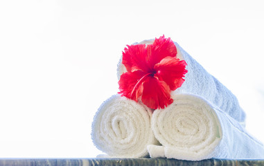 rolled beach or spa towels isolated over white background