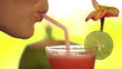 Close up of woman face drinking fruit cocktail through straw