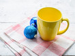 Yellow cup with christmas decoration.