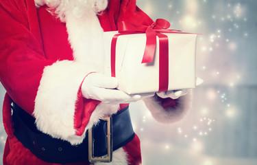 Santa Claus Giving a Christmas Present