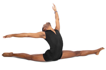 male ballet dancer warming up and showing flexibility