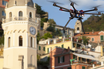 A flying drone  with a blurred background