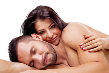 Image of nude lovers smiling dreamily at camera