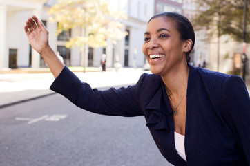 business woman hailing a taxi.
