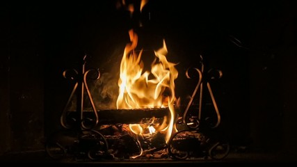 close up of fireplace and wood burning slow motion