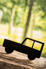 cut out car silhouette over forest background