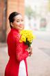 Charming Vietnamese girl holding flowers