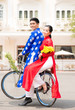 Young Vietnamese couple riding a bicycle