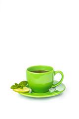 Green mug with lemon and mint