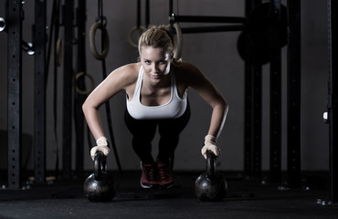 Push-ups on kettlebells