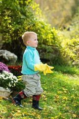boy planting flowers in the garden