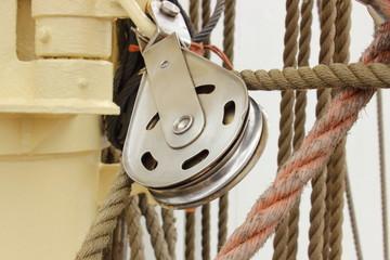 Old metal block and rigging at the sailboat